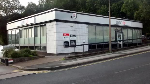 UPDATED: Armed robber attacks security guard with hammer at HSBC in Astley Bridge